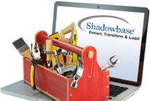Stock photo of small toolbox with handyman tools on a laptop