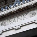 "Stock photo of ""BANK"" inscription on stone building"