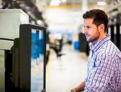 HPE stock photo of man staring at a screen