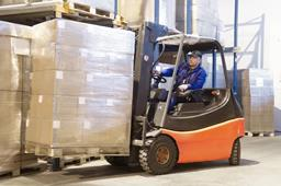 Stock photo of a man operating a forklift