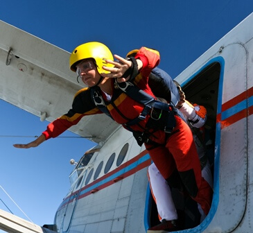 Stock photo of a man skydiving out of an airplane