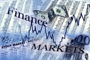 """Stock photo with the words """"finance, markets, stock market ratio,"""" and different stock reports on paper"""