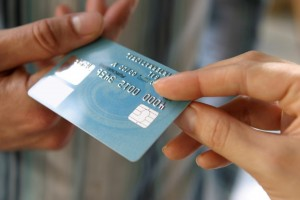 Stock photo of credit card transferring hands