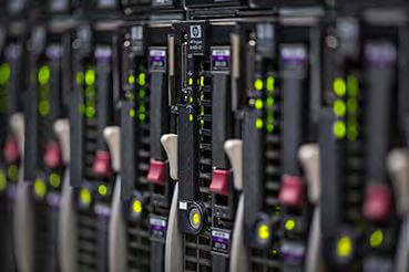HPE stock photo of PCs stacked vertically next to each other