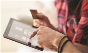 HPE stock photo of two people looking at tablet and holding credit card