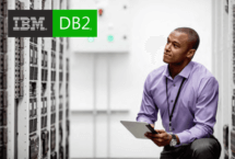 IBM DB2 logo on HPE stock photo of man staring at servers in server room